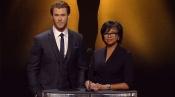 Chris Hemsworth dando la lista de nominados a los Oscar 2014 junto a Cheryl Boone
