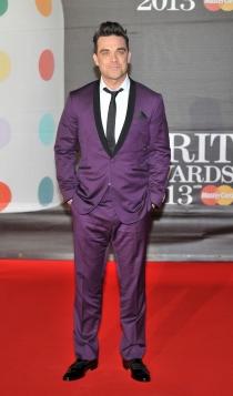 Robbie Williams, encantado con sus trajes coloridos