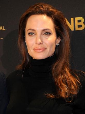 Angelina Jolie y Pitt salvan su matrimonio con otra adopción