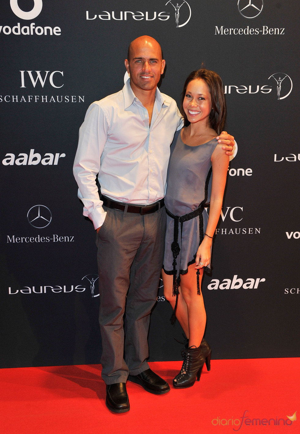 El surfista Kelly Slater y su pareja en la Laureus Welcome Party