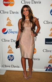 Miley Cyrus en la fiesta previa a los Grammy 2011