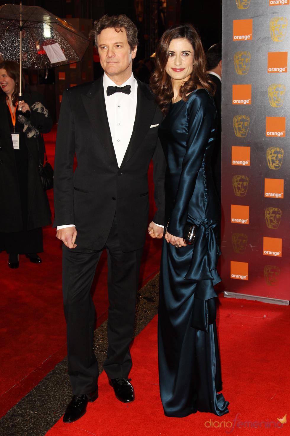 Colin Firth y Livia Giuggioli en la alfombra roja de los Bafta 2011