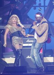 Paulina Rubio y Wyclef Jean en los Billboard Latinos