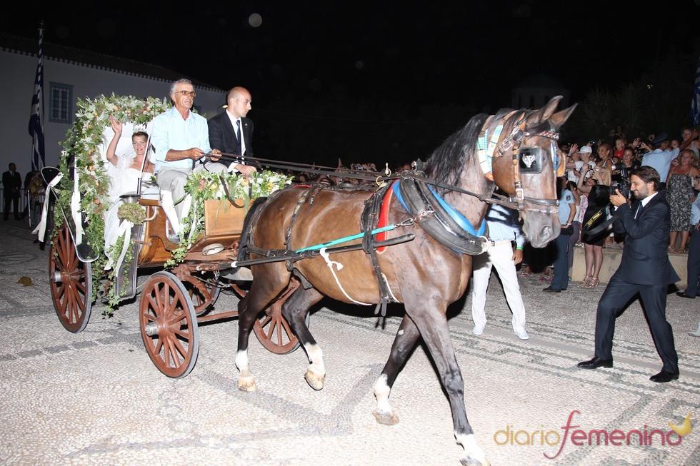 Tatiana Blatnik en coche de caballos