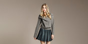 Falda plisada y jersey gris de zara