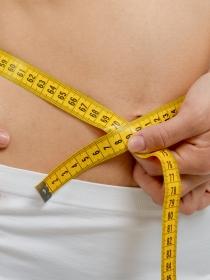 Calcular el peso ideal de acuerdo con el peso y la altura de la mujer