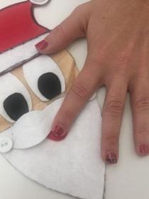 Diseño de uñas divertido de Papá Noel para Navidad