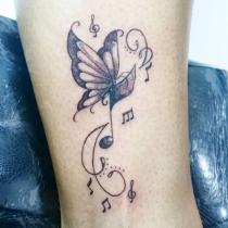 Significado de tatuajes con notas musicales: el sentido de la música